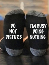 Black I'm Busy Doing Nothing socks